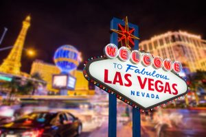 44286313 - welcome to fabulous las vegas nevada sign with blur strip road background