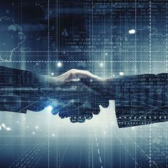 Image of two businesspeople shaking hands