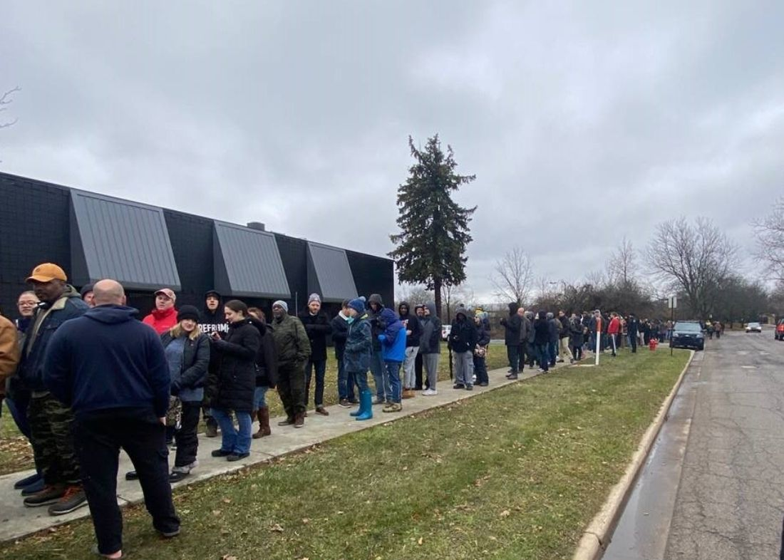 On first day of Michigan recreational marijuana sales, customers line up for flower