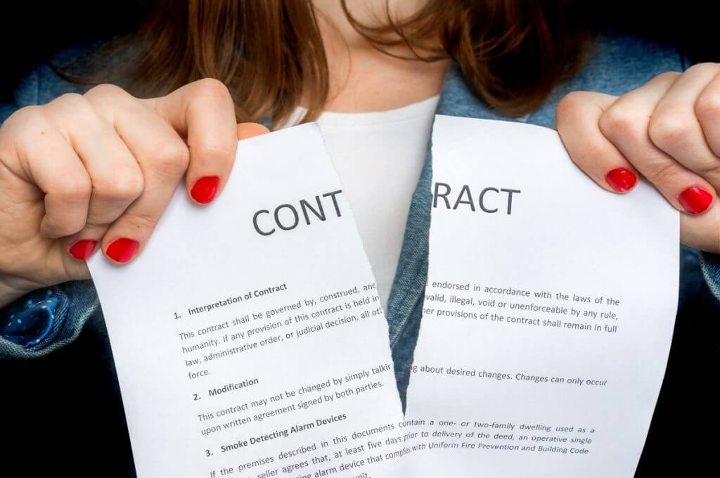 Image of contract being torn in half