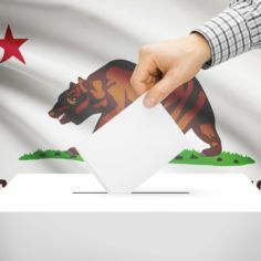 Image of a voting box in front of California state flag