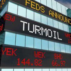 Turmoil Volatility Stock Market Ticker with the word TURMOIL on it