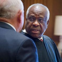 Supreme Court Justice Clarence Thomas talks with Ag Secretary Sonny Perdue in 2017