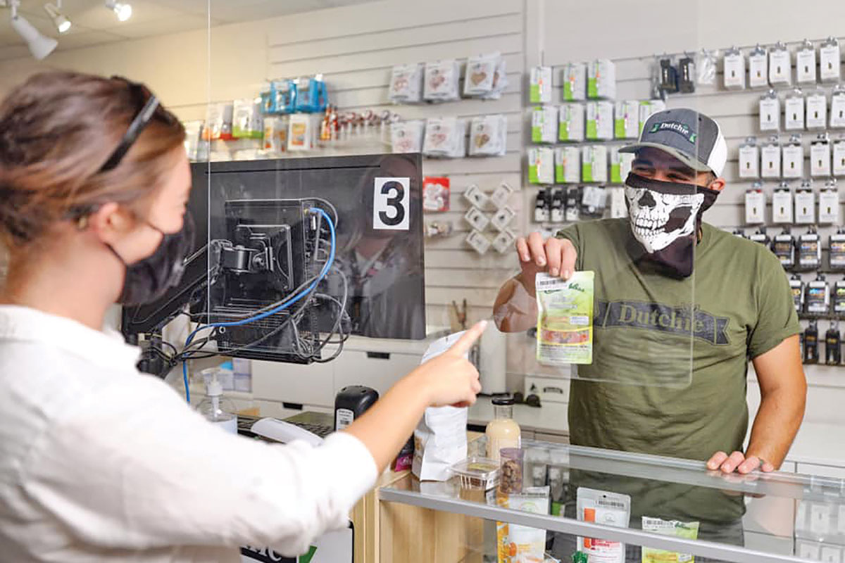 Image of a budtender helping a customer